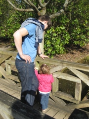 toddler playing pooh sticks
