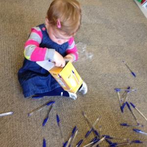 Toddler spilling pens